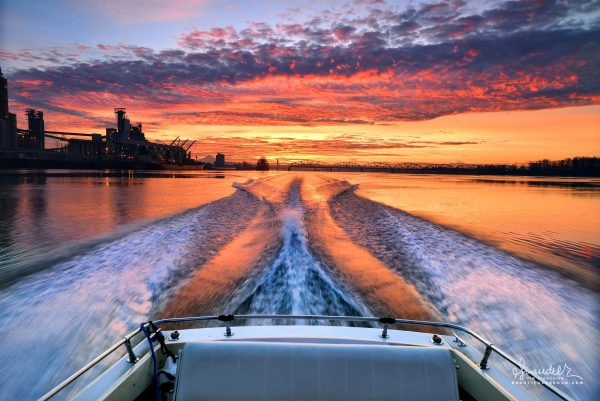 sunrise motorboat on Columbia River. Port of Vancouver Multnomah County
