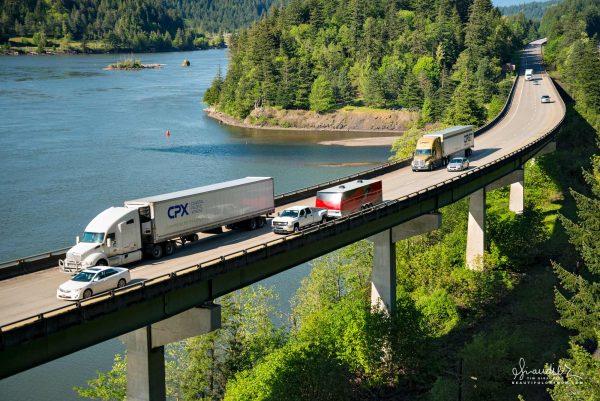 Interstate 84, traffic and semi-trucks head west along the Columbia River near Bonneville Dam.