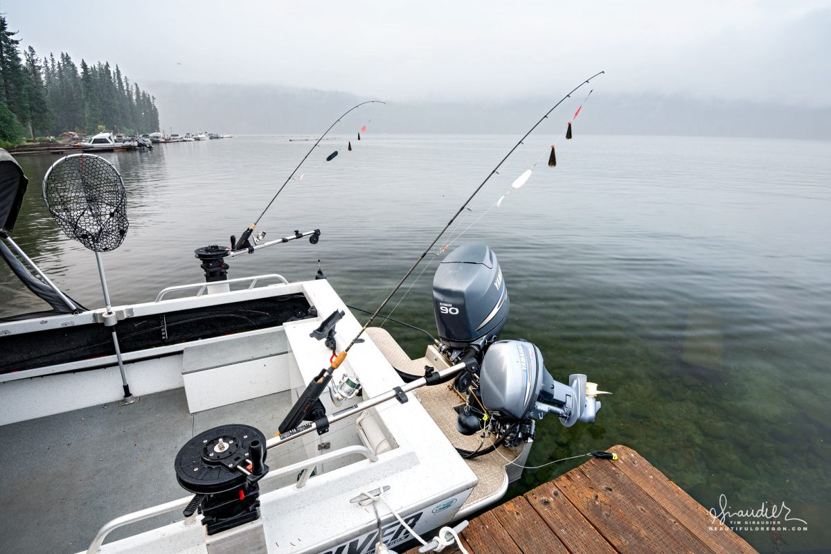 A fishing boat moored at Odell Lake is geared up and ready for a day of trolling kokanee. Deschutes National Forest, Central Oregon Cascades.