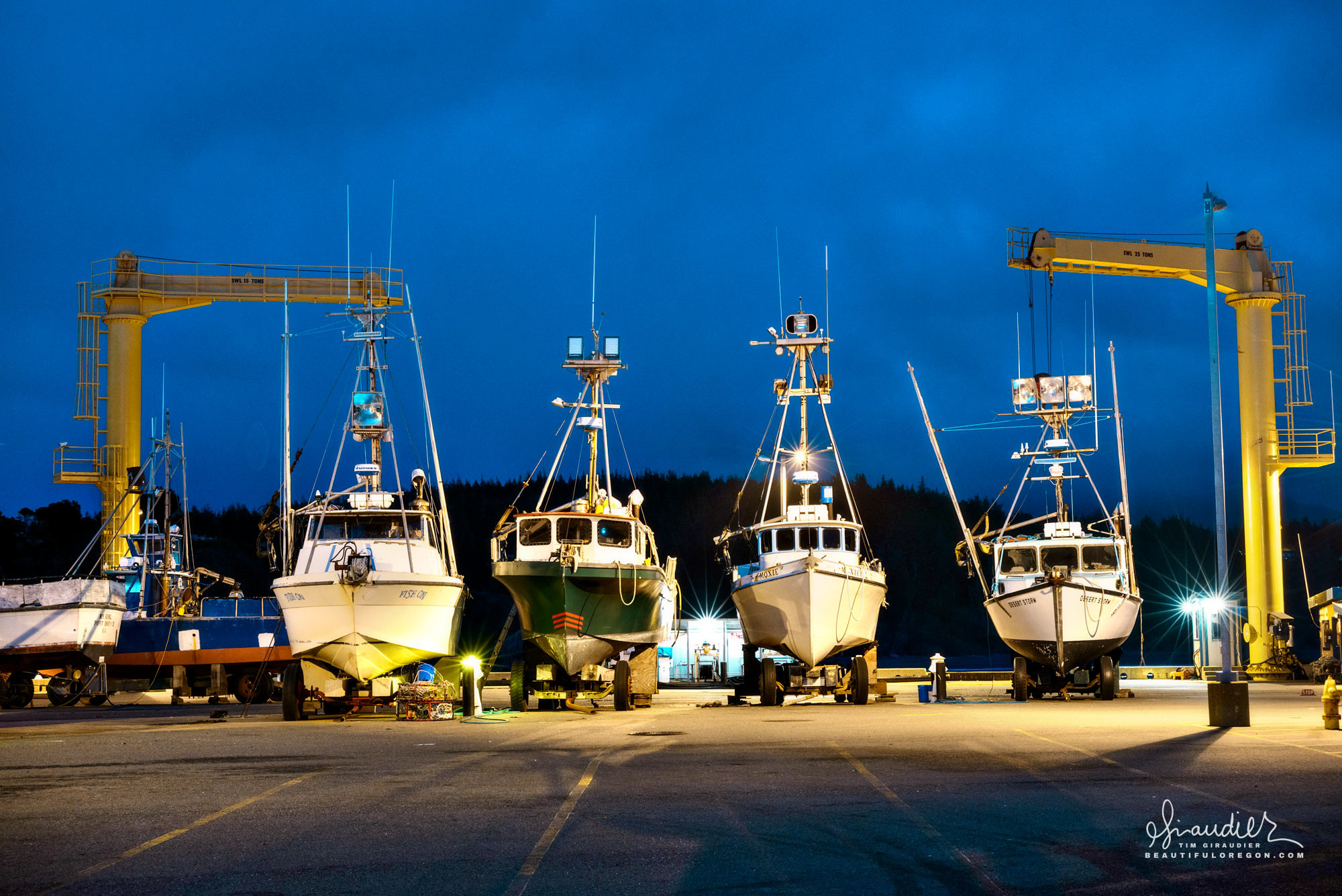 In Port Orford the fishing fleet is hoisted from the sea and safely stored upon repurposed truck chassis. Curry County, Oregon South Coast.