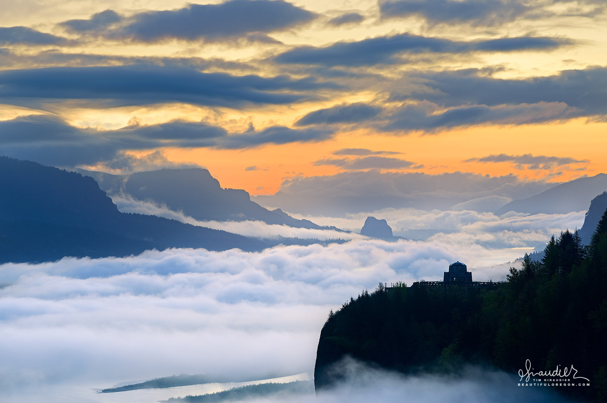 Sunrise fog over Vista House and the Crown Point State Scenic Corridor. Multnomah County, Columbia River Gorge, Oregon.