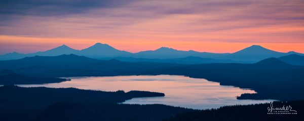Morning view of Waldo Lake and the Central Oregon Cascades. In background is The Three Sisters and Mount Bachelor. Willamette National Forest, Lane County, Oregon landscape photography