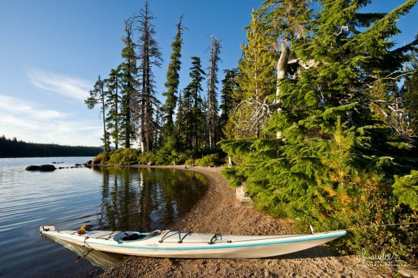 Waldo Lake, Kayak at Rhododendron Island. Willamette National Forest, Central Oregon Cascades.
