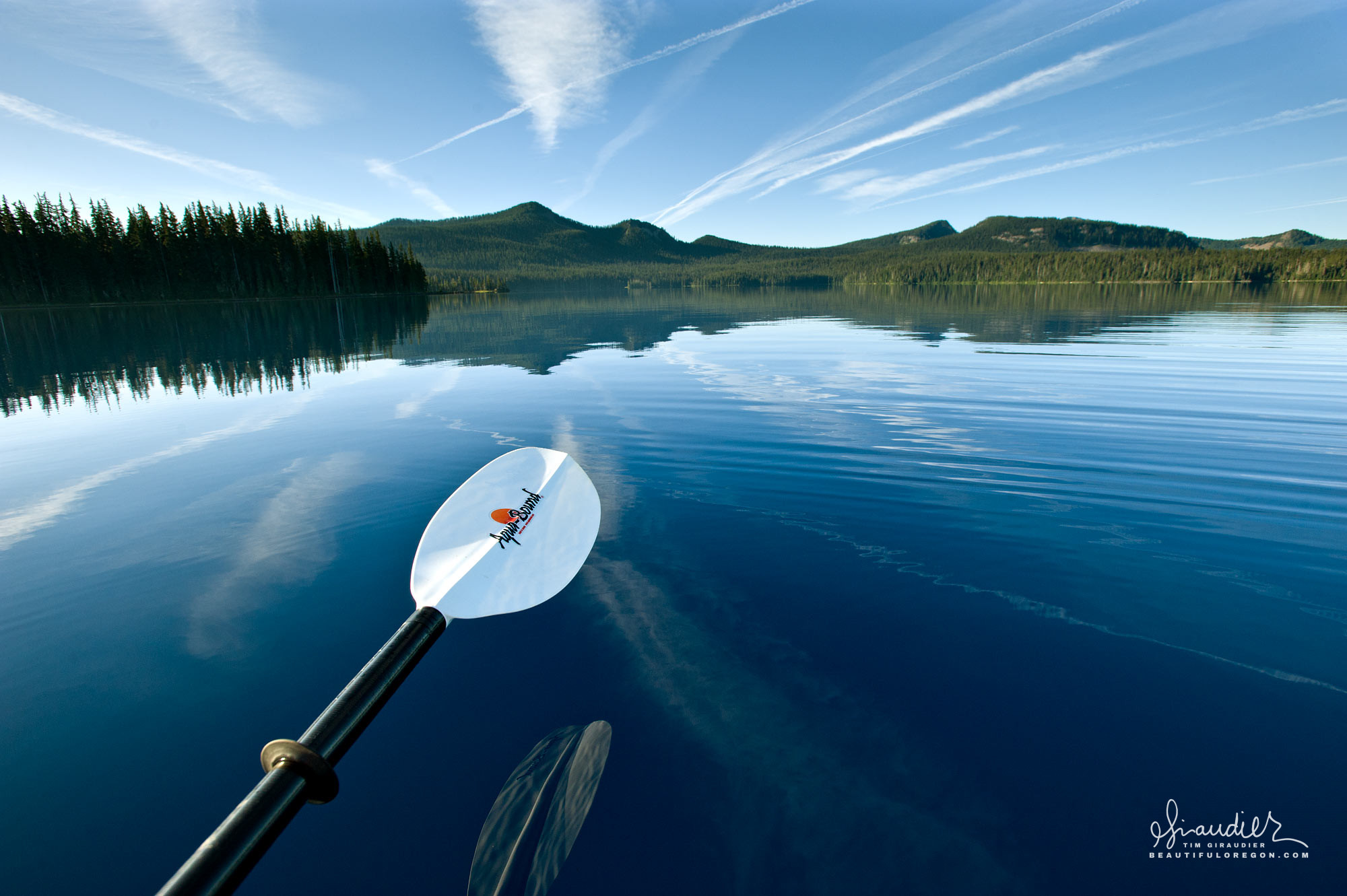 Kayak paddling Waldo Lake. Willamette National Forest, Central Oregon Cascades.
