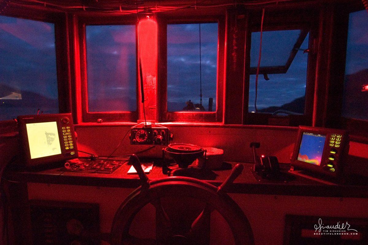 Night watch aboard an Alaskan salmon troller as it heads east through the Inside Passage. Wrangle Narrows, SE Alaska.