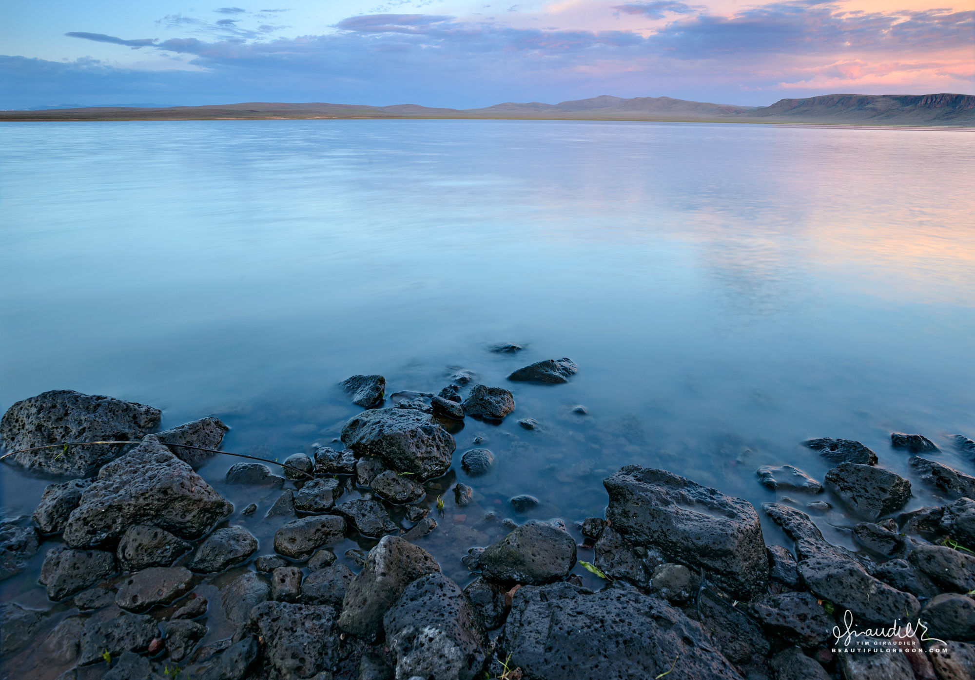 Dawn over Antelope Reservoir with Juniper Ridge in the distance. Malheur County, Southeastern Oregon.