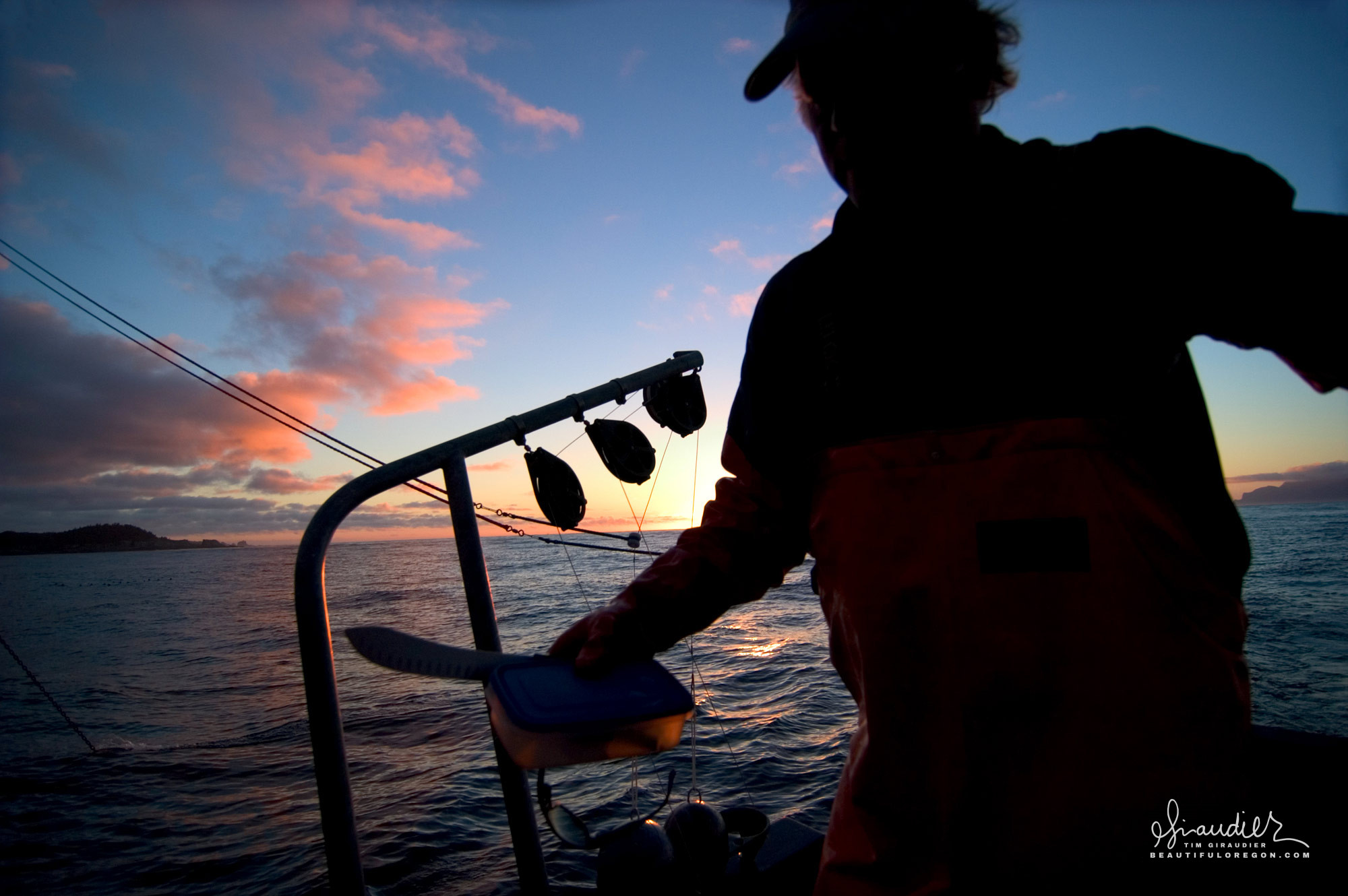 Alaskan fisherman, Rick Oltman of the Cape Cleare has pulled his fishing gear at days end and heads to a protected anchor for the night. Cross Sound, Southeast Alaska sustainable salmon troll fishery.