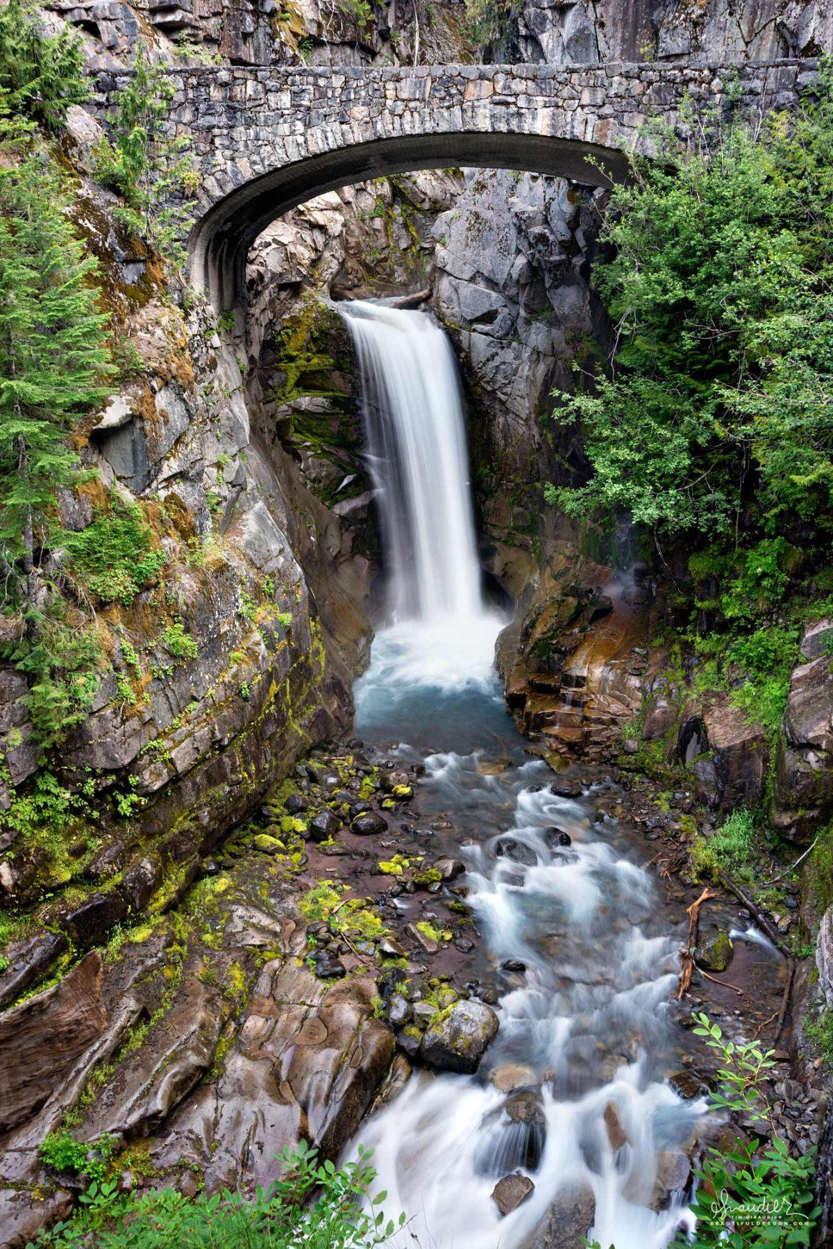 Christine Falls, beautifully framed by the stone masonry of the S.R.706 bridge. Mount Rainier National Park, Washington Cascades.