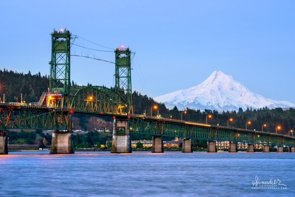 With Mount Hood in the background, the Hood River Bridge spans the Columbia River between White Salmon and Hood River Oregon. Klickitat County, Hood River County, Columbia River Gorge.