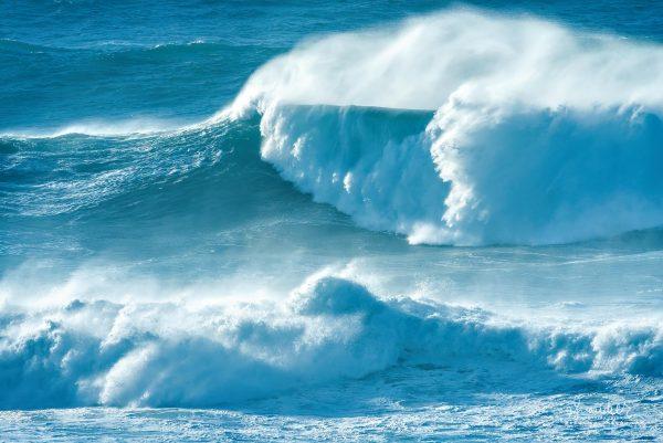 Oregon coast storm waves pile ashore in dangerous surf at Cape Perpetua. Lincoln County, Central Oregon Coast.