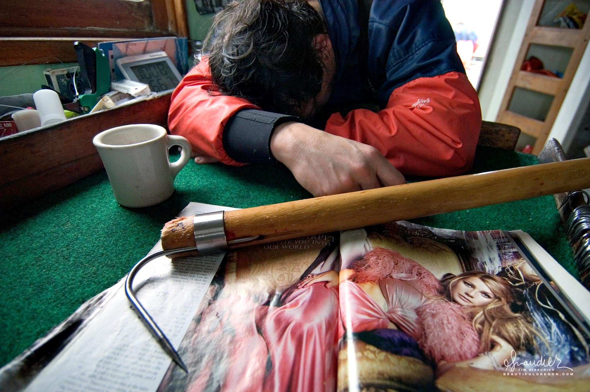 A crewman passes out for a catnap while troll fishing for King and Silver Salmon. Cross Sound, Gulf of Alaska.