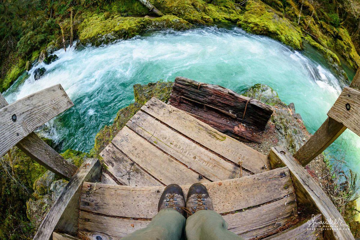 Taking a break for lunch on the flood damaged footbridge of lower Salmon Creek. Willamette National Forest, Oregon Cascades.