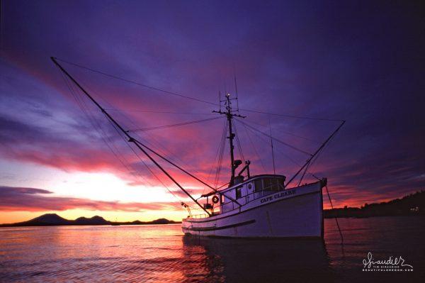 Colorful sunset light over F/V Cape Cleare. Sitka Harbor, Southeast Alaska.
