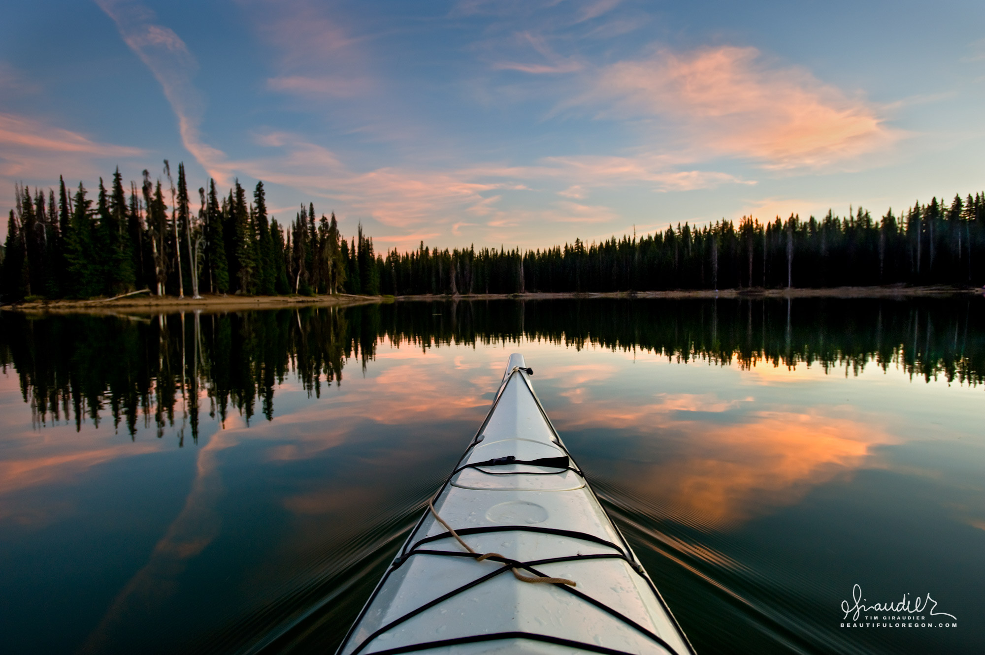 Sparks Lake kayak paddle at dusk. Cascade Lakes Highway, Deschutes National Forest, Central Oregon Cascades outdoors recreation vacation.
