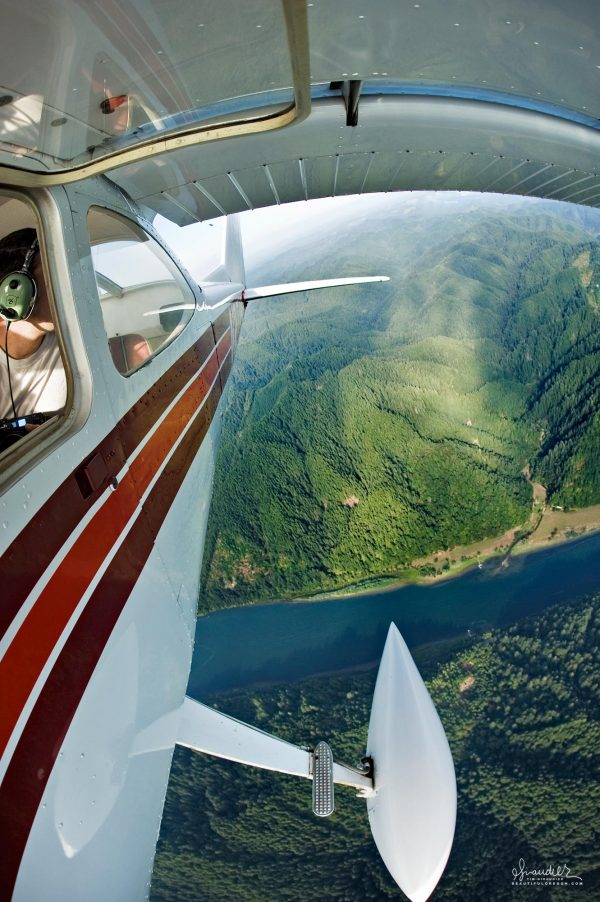 Flying north over the Umpqua River, a Cessna light aircraft returns from surveying the Elliott State Forest. Siuslaw National Forest. Douglas County, Oregon Coast Range.