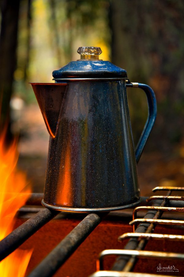 Campfire coffee over an open flame. Even bad coffee almost tastes great after a long night of winter tent camping. The joy of camp cooking.