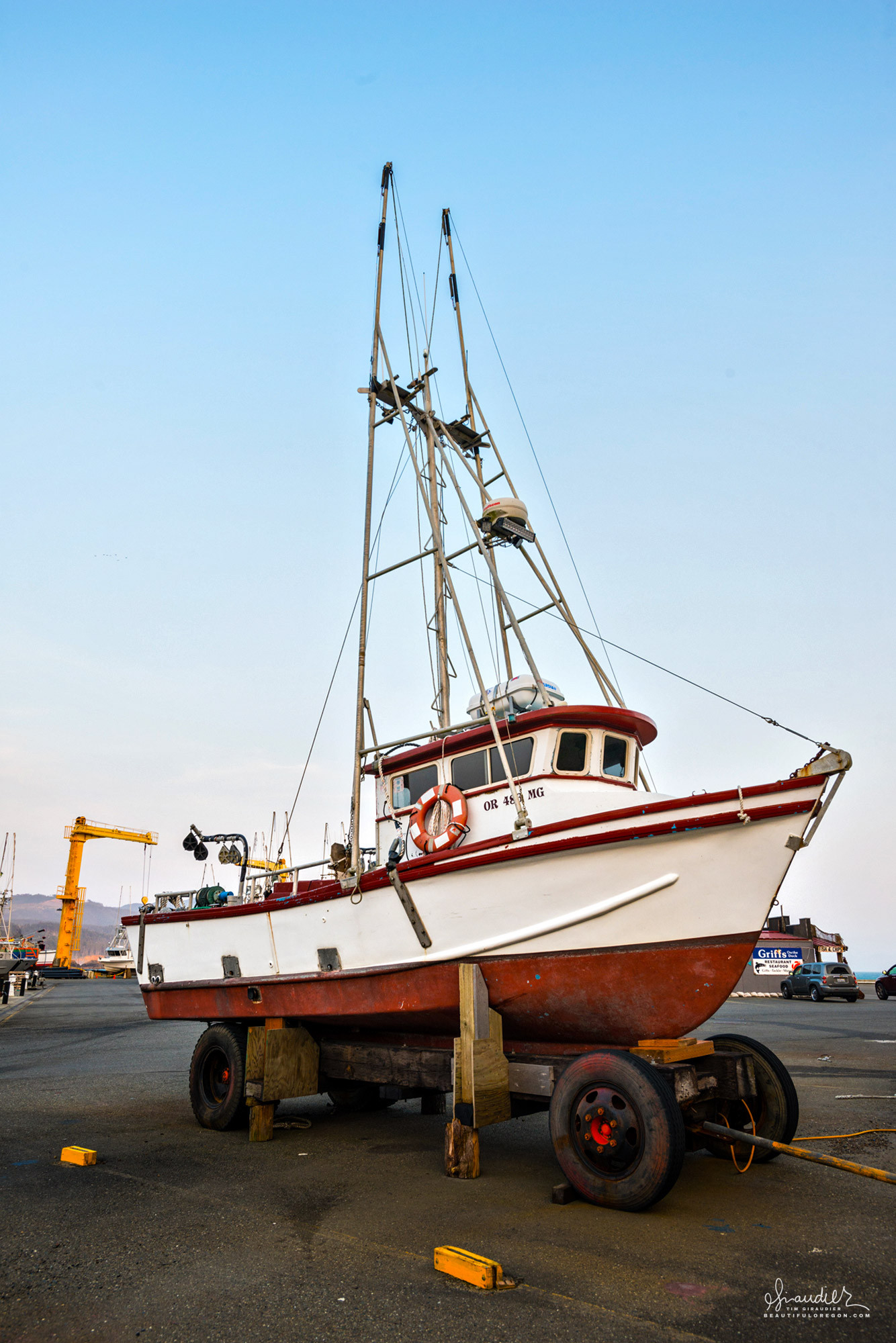 With Port Orford's harbor offering little protection from the weather, its fleet of commercial fishing boats, is stored on improvised carriages. Curry County, South Oregon Coast.