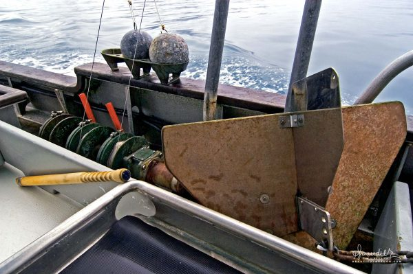 Cannonball downriggers, gurdies and a stabilizer, familiar components of a West Coast commercial salmon troller. Sustainable hook and line salmon troll fishing.