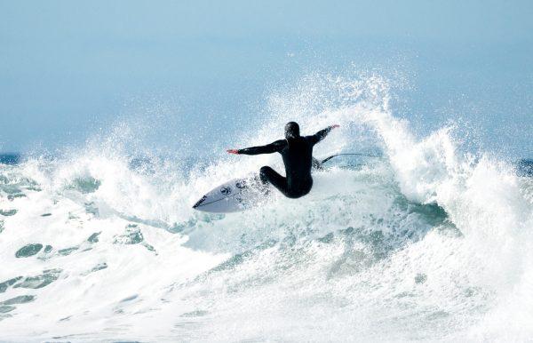 A surfer at Cape Kiwanda makes riding Oregon's wild waves look easy. Pacific City, Tillamook County, Oregon Central Coast.