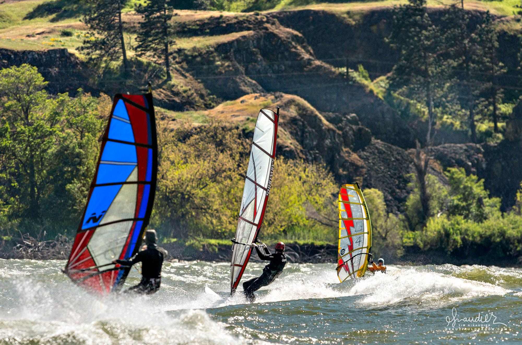 Windsurfers ride high winds at east end of Columbia River Gorge. Hood River County, Oregon.