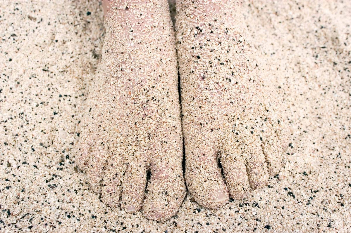 Sandy toes in warm sand, a perfect day at the beach!